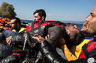 Lifeguards from the Spanish organization Proactiva carry a man to shore on Lesvos, Greece after he lost consciousness while traveling across the Aegean Sea from Turkey on a rubber raft with a group of asylum seekers on October 29, 2015. It is presumed that the man was suffering from hypothermia and low blood sugar.