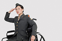 Female US military officer in wheelchair saluting over gray backgrounds