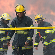 Sunday, June 27, 2010 (Kriston J. Bethel / Staff Photographer).34th and Clearfield; firefighters battle four alarm fire.Firefighters battle not only flames, but the day's heat, as they work to put out a four alarm fire in temperatures exceeding 90 degrees.