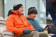 Spectators wrapped up warm they await the start of play during the first day of the Specsavers County Champ Div 1 match between Hampshire County Cricket Club and Essex County Cricket Club at the Ageas Bowl, Southampton, United Kingdom on 5 April 2019.