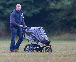 Mike Tindall pushes baby Mia as they watch Zara Phillips compete on High Kingdom in the dressage. Image ©Licensed to i-Images Picture Agency. 02/08/2014. Minchinhampton, United Kingdom. Gatcombe Festival of Eventing. Gatcombe Park. Picture by i-Images