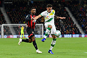 Ben Godfrey (4) of Norwich City holds off Jermain Defoe (18) of AFC Bournemouth during the EFL Cup 4th round match between Bournemouth and Norwich City at the Vitality Stadium, Bournemouth, England on 30 October 2018.