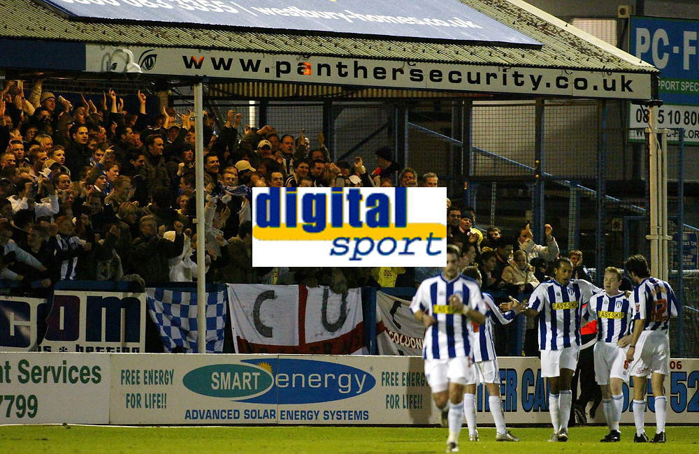 Photo: Chris Ratcliffe.<br />Colchester United v Bristol City. Coca Cola League 1. 17/01/2006.<br />Colchester players celebrate Gareth Williams' goal in front of the terracing at Layer Road.