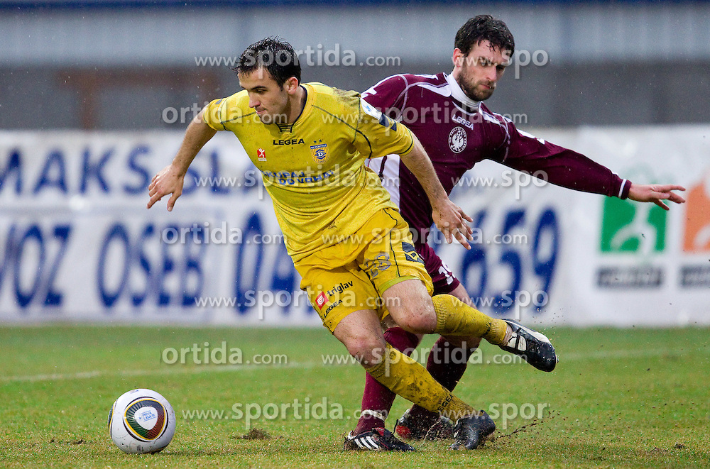 Mato Simunovic of Domzale vs Dragan Ovcina of Triglav in action during football match between NK Domzale and Triglav Gorenjska in 23rd Round of 1st Slovenian League PrvaLiga, on March 16, 2011 in Sports park Domzale, Domzale, Slovenia. Domzale defeated Triglav 3-1. (Photo By Vid Ponikvar / Sportida.com)