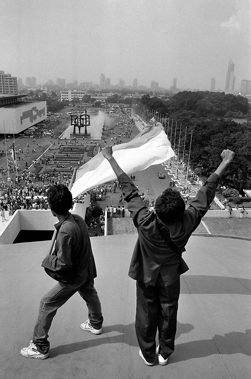 Students celebrate from the top of the People's Consultative Assembly as Suharto's 32 year rule comes to an end, May 21 1998.