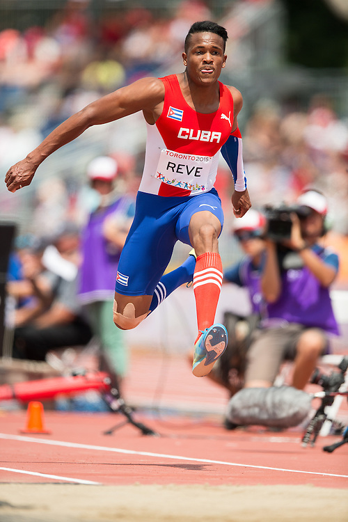 Ernesto Reve of Cuba competes in the men's triple jump at CIBC Athletics Stadium at the 2015 Pan American Games in Toronto, Canada, July 24,  2015.  AFP PHOTO/GEOFF ROBINS
