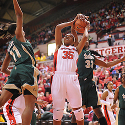 Jan 31, 2009; Piscataway, NJ, USA; Rutgers guard Brittany Ray (35) has a shot blocked by South Florida center Brittany Denson (32) during the second half of South Florida's 59-56 victory over Rutgers in NCAA women's college basketball at the Louis Brown Athletic Center