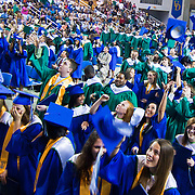 060211 Newark DE: 221 St.Georges Tech HS students celebrate by tossing their caps in the air during the final moments of St.Georges Tech HS graduation ceremony Thursday, June 2, 2011, at The Bob Carpenter Center in Newark Delaware.<br /> <br /> Special to The News Journal/SAQUAN STIMPSON