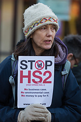 Uxbridge, UK. 1 February, 2020. Environmental activists from Stop HS2, Save the Colne Valley and Extinction Rebellion campaign against the controversial HS2 high-speed rail link in Uxbridge town centre during a 'Still Standing for the Trees' march from the Harvil Road wildlife protection camp in Harefield through Denham Country Park to three addresses closely linked to Boris Johnson in his Uxbridge constituency. The Prime Minister is expected to make a decision imminently as to whether to proceed with the high-speed rail line.