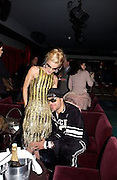 David la Chapelle and Daphne Guinness, Tanqueray Philip Treacy couture fashion show and after party,  Pink Paradise Club, Paris. 21 January 2003. © Copyright Photograph by Dafydd Jones 66 Stockwell Park Rd. London SW9 0DA Tel 020 7733 0108 www.dafjones.com