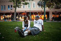 Santa Fe, New Mexico - September 27, 2014: A couple enjoys the sunset at the Plaza in Santa Fe. The Plaza has been the heart of downtown Santa Fe for 400 years, and hosts markets and community events year-round. CREDIT: Chris Carmichael for the New York Times  CREDIT: Chris Carmichael for the New York Times