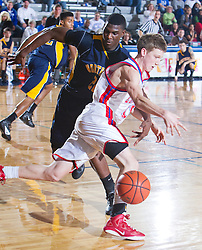 Jacob Jeter, right, Northeast's Alex Poythress, left, reaches in and fouls Lafayette's Lafayette hosted Northeast (TN)  Saturday, Jan. 07, 2012 at Lexington Catholic Gym in Lexington.