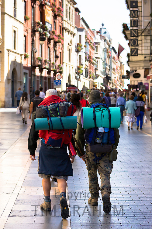 Pilgrims travelling on Camino Santiago reach Calle Ancha in Leon, Castilla y Leon, Spain