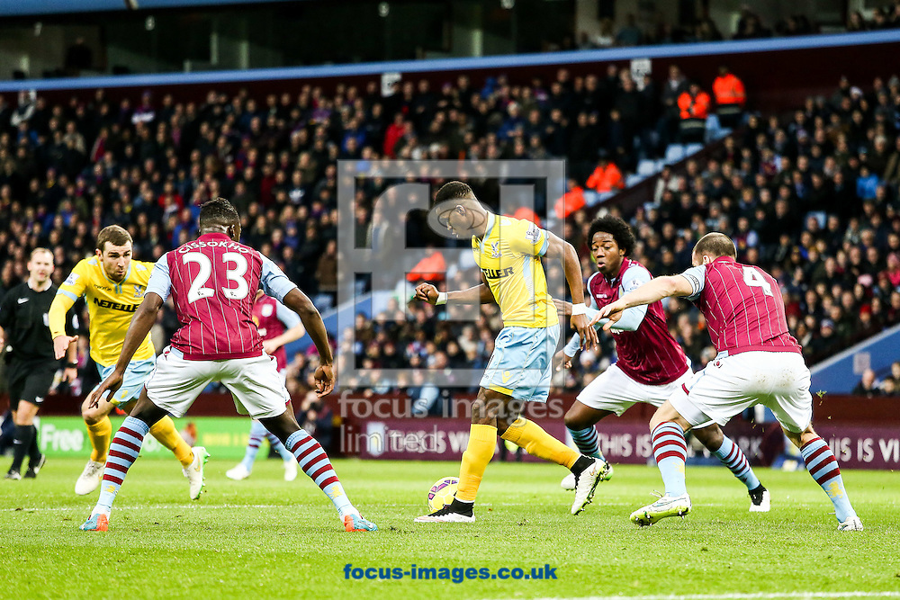 Wilfried Zaha of Crystal Palace (centre) during the Barclays Premier League match at Villa Park, Birmingham<br /> Picture by Andy Kearns/Focus Images Ltd 0781 864 4264<br /> 01/01/2015