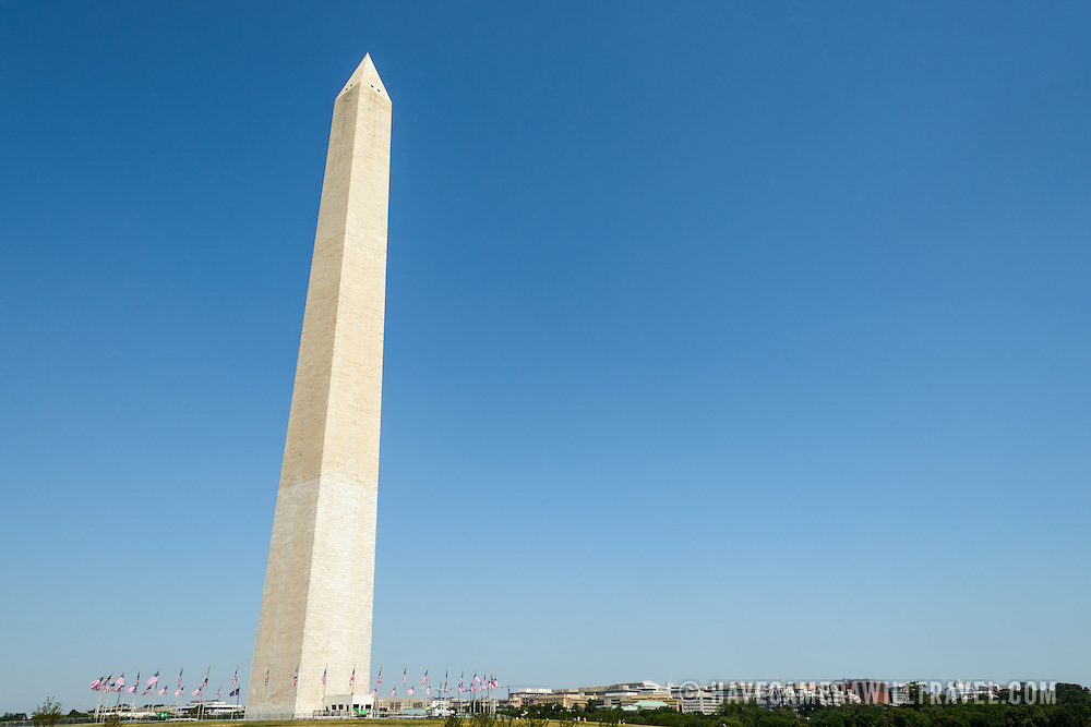 Washington Monument with Clear Blue Sky and Copyspace. The Washington Monument, one of the National Mall's most distinctive landmarks, on a clear sunny day with blue sky.