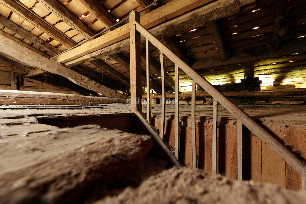 empty raw attic roof space with stairs