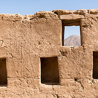 The well-preserved adobe walls of the Incan archaeological site of Tambo Colorado, Pisco, Ica Region, Peru