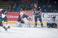 KELOWNA, CANADA - OCTOBER 22: Cole Martin #8 stands by the net of Jackson Whistle #1 of the Kelowna  against the Calgary Hitmen on October 22, 2013 at Prospera Place in Kelowna, British Columbia, Canada.   (Photo by Marissa Baecker/Shoot the Breeze)  ***  Local Caption  ***