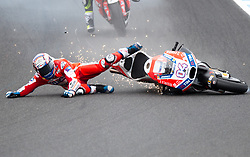 October 21, 2017 - Melbourne, Victoria, Australia - Italian rider Andrea Dovizioso (#4) of Ducati Team crashes at turn nine during the fourth free practice session at the 2017 Australian MotoGP at Phillip Island, Australia. (Credit Image: © Theo Karanikos via ZUMA Wire)