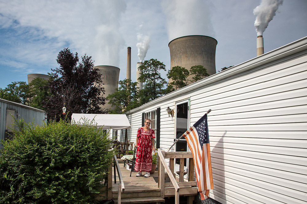 Barbara Glen on her deck outside of their trailer home in Raymond City, West Virginia across from the John Amos coal-fired power plant.