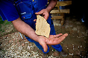"A worker for Semir Osmanagic displays a casting found near the Pyramid of the Moon...Bosnian Pyramids.Visoko, Bosnia and Herzegovina. **The authenticity of the ""Bosnian Pyramids"" has been a point of heated debate in the scientific community**"