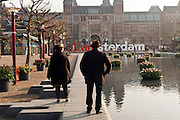early morning Amsterdam Museumplein with the Rijksmuseum