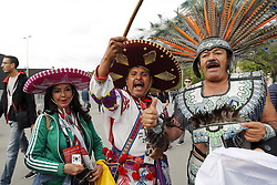 fans of Mexico with feather in traditional clothing and sombrero