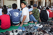 Uzbek men attend Friday prayers at the Mamakhan Ogly Nobijon Hajji Mosque in the Cheremushki mahalla, Osh. July 2, 2010.
