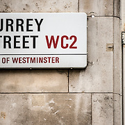 Street signs for Surrey Street WC2 in the City of Westminster in central London.