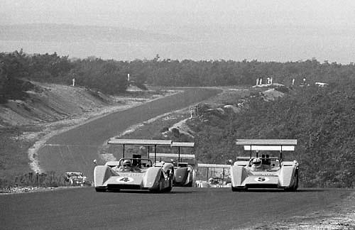 Pace lap of 1969 Bridgehampton Can-Am, with Bruce McLaren on pole in McLaren M8B no. 4 alongside team mate Denny Hulme (5); PHOTO BY Pete Lyons 1969 / © 2014 Pete Lyons/www.petelyons.com;