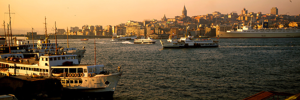 TURKEY, ISTANBUL, ferryboat activity on the Golden Horn near the Galata Bridge, with the Beyoglu area and the Galata Tower beyond