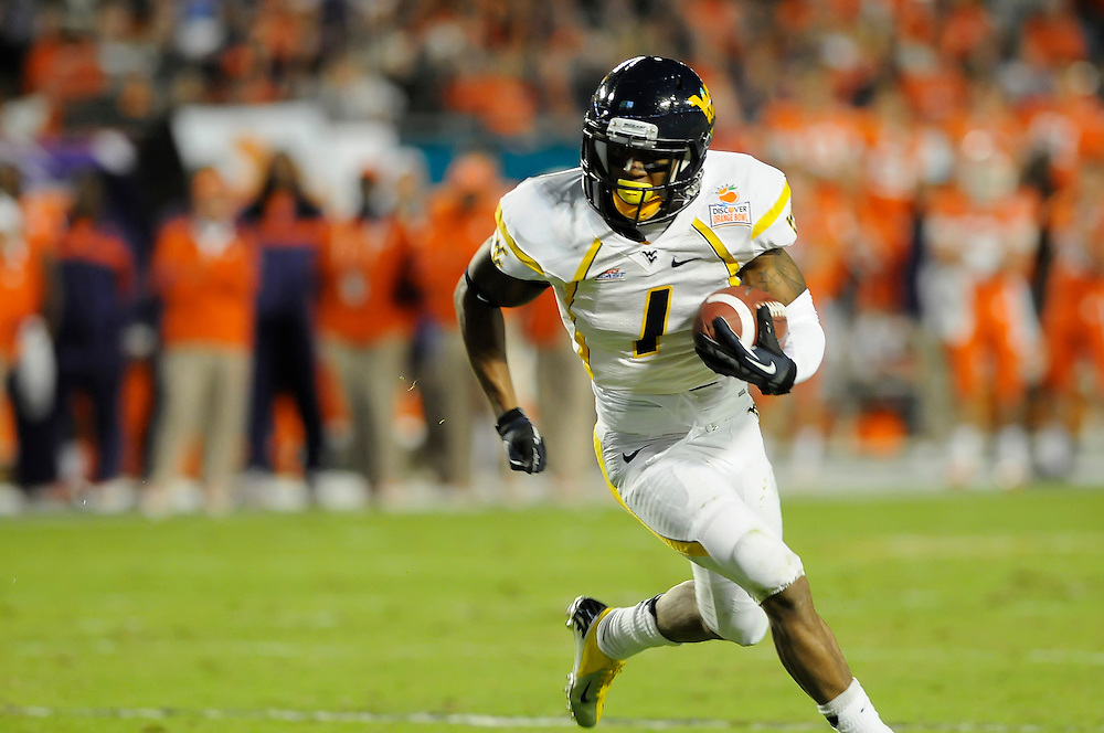 January 4, 2012: Tavon Austin #1 of West Virginia runs upfield after a catch during the NCAA football game between the West Virginia Mountaineers and the Clemson Tigers at the 2012 Discover Orange Bowl at Sun Life Stadium in Miami Gardens, Florida.