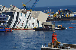 60484305  Isola del Giglio, Italy. Work begins today to right the stricken Costa Concordia vessel, which sank on January 12, 2012. If the operation is successful, it will then be towed away and scrapped. The procedure, known as parbuckling, has never been carried out on a vessel as large as Costa Concordia before, Italy, Monday September 16, 2013.<br /> Picture by imago / i-Images<br /> UK ONLY