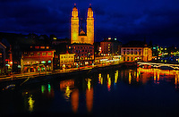 Night view of the Limmat River and Limmatquai (Grossmunster Cathedral in center), Zurich, Switzerland
