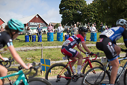 Spectators entertain the riders with makeshift drums during the 141 km road race of the UCI Women's World Tour's 2016 Crescent Vårgårda women's road cycling race on August 21, 2016 in Vårgårda, Sweden. (Photo by Balint Hamvas/Velofocus)