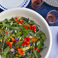 A summer salad of mixed mesclun greens and edible flowers.