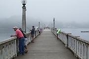 People fishing on the footbridge across the Passagassawakeag River in Belfast, Maine.