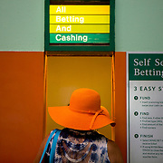 ELMONT, N.Y. - JUNE 6, 2015: A racegoer places a bet prior to the 147th running of the Belmont Stakes at Belmont Park. CREDIT: Sam Hodgson for The New York Times
