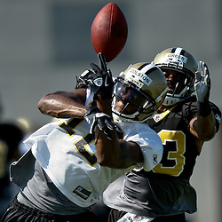 July 31, 2011; Metairie, LA, USA; New Orleans Saints cornerback Jabari Greer (33) deflects a pass from wide receiver Marques Colston (12) before intercepting the ball during training camp practice at the New Orleans Saints practice facility. Mandatory Credit: Derick E. Hingle