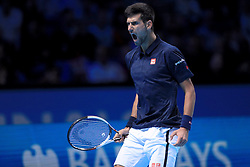 Serbia's Novak Djokovic celebrates during his match against Austria's Dominic Thiem during day one of the Barclays ATP World Tour Finals at The O2, London.