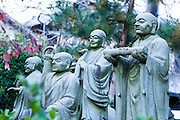 A lot of stone monk statues in a temple, Kyoto, Japan
