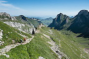 View looking east from pastures of Meglisalp along the Rotsteinpass trail, in the Alpstein limestone mountain range, Appenzell Alps, Switzerland, Europe. Appenzell Innerrhoden is Switzerland's most traditional and smallest-population canton (second smallest by area).