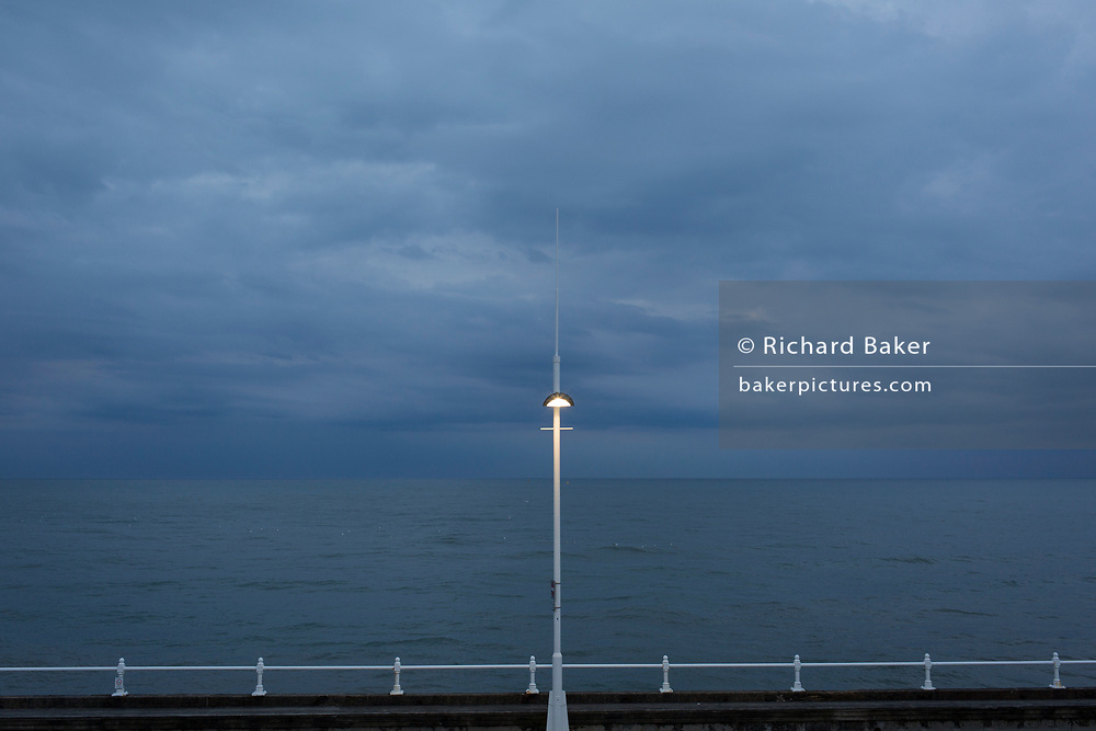 New lighting on top of a post overlooking approaching storm clouds and the North Sea, on 13th July 2017, at Bridlington, East Riding, England.
