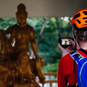Andrew Whiteford takes a photo of a Budda near Chiang Mai, Thailand.