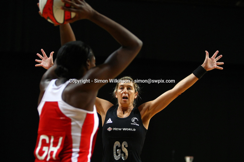 PICTURE BY VAUGHN RIDLEY/SWPIX.COM...Netball - International Netball Series - England v New Zealand - MEN Arena, Manchester, England - 15/01/11...New Zealand's Irene van Dyk defends against England's Sonia Mkoloma.