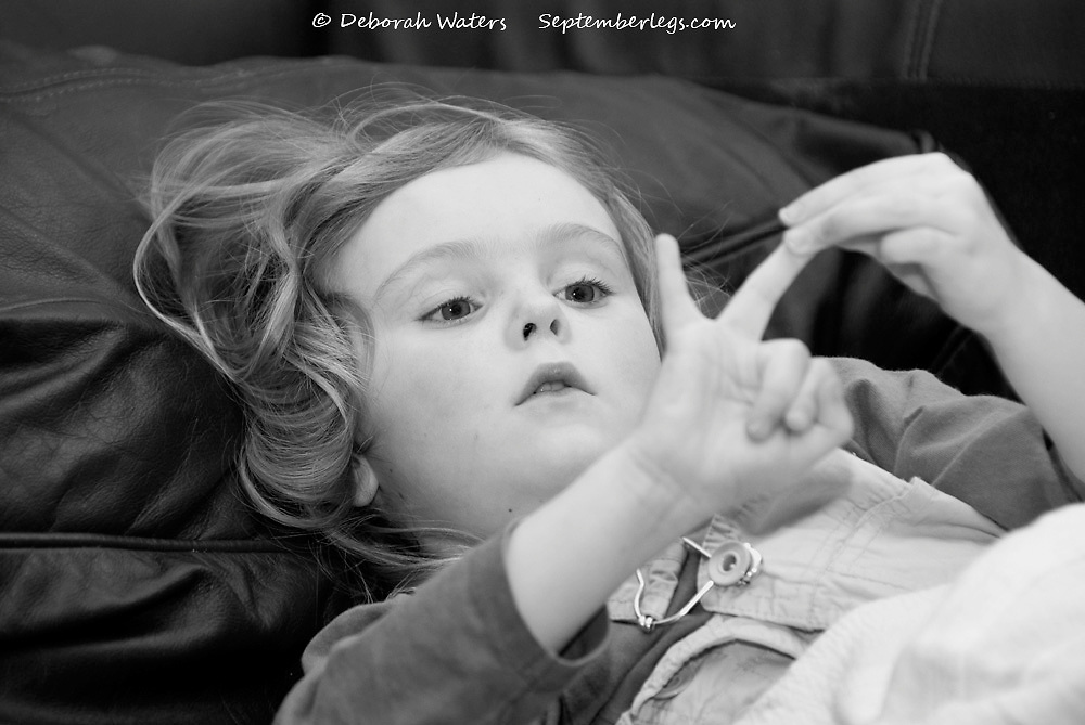 Young girl absorbed in counting on her fingers. Black and white candid portait