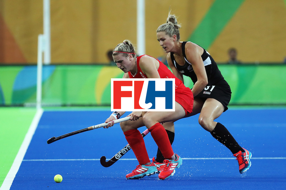 RIO DE JANEIRO, BRAZIL - AUGUST 17:  Stacey Michelsen #31 of New Zealand and Lily Owsley #26 of Great Britain in action during the Women's Semifinal match between New Zealand andGreat Britain on Day 12 of the Rio 2016 Olympic Games at the Olympic Hockey Centre on August 17, 2016 in Rio de Janeiro, Brazil.  (Photo by Rob Carr/Getty Images)