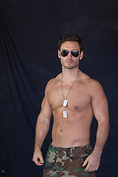 hot muscular Army man wearing sunglasses