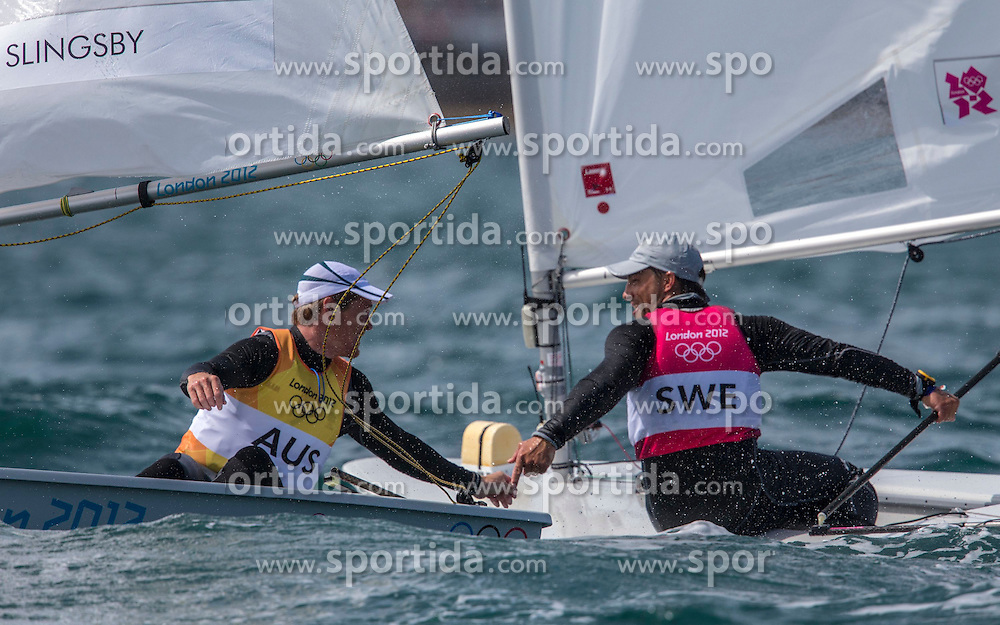 06.08.2012, Bucht von Weymouth, GBR, Olympia 2012, Segeln, im Bild GOLD.Slingsby Tom, (AUS, Laser).BRONZE.Myrgren Rasmus, (SWE, Laser). // during Sailing, at the 2012 Summer Olympics at Bay of Weymouth, United Kingdom on 2012/08/06. EXPA Pictures © 2012, PhotoCredit: EXPA/ Daniel Forster ***** ATTENTION for AUT, CRO, GER, FIN, NOR, NED, POL, SLO and SWE ONLY!