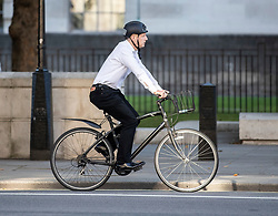 © Licensed to London News Pictures. 25/07/2019. London, UK. Newly appointed Business Secretary Jo Johnson cycles on Whitehall before attending Cabinet. The Conservative Party has elected Boris Johnson as their new leader and Prime Minister, following Theresa May's resignation. Photo credit: Peter Macdiarmid/LNP